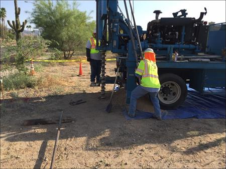 Workers doing Geotech drilling on South Mountain Freeway Project