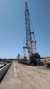 100-ton crane standing adjacent to Interstate 10 near 59th Avenue