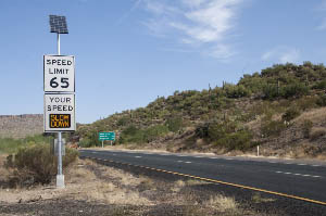 Speed Limit sign along I-17 with dynamic message: Slow Down