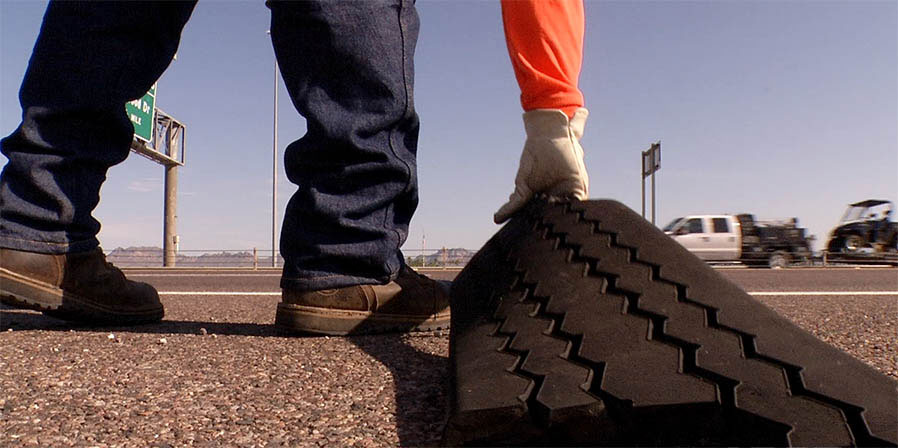Tire Rubber picked up by highway worker after tire blowout