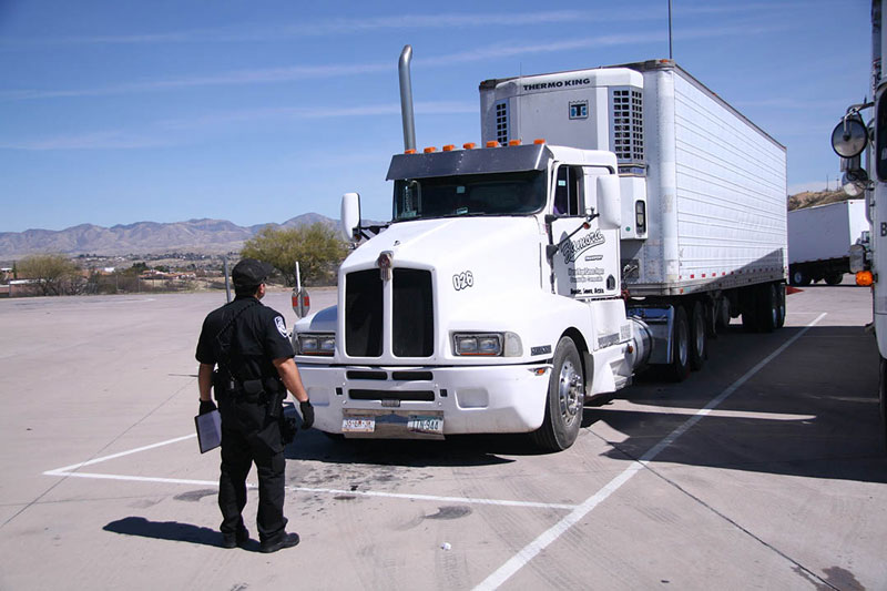 Enforcement and Compliance officer inspecting commercial truck