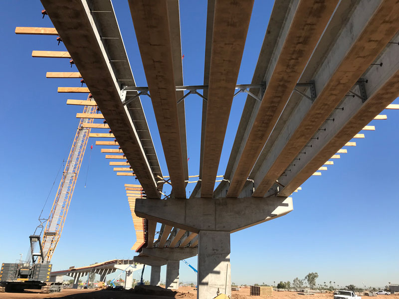Underneath a South Mountain Freeway flyover bridge