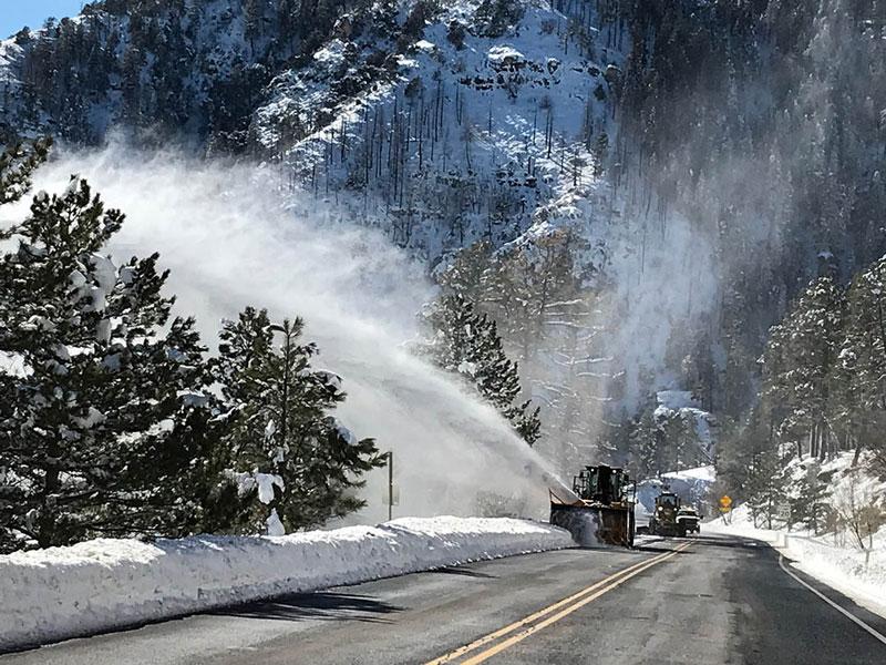 ADOT Snowplow removing snow on SR 89A
