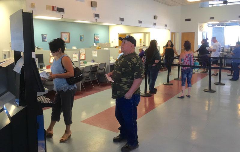 Customers using the Service Arizona Kiosk in the Yuma MVD Office