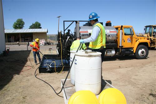 Oil truck being clean in the catch basin