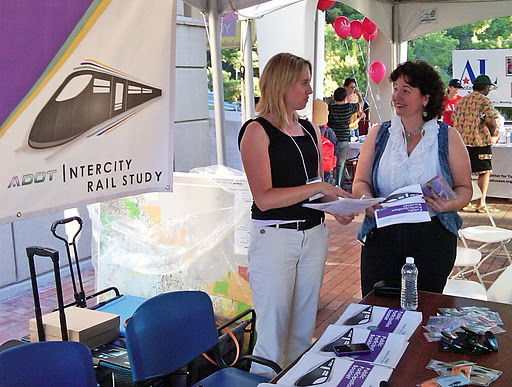Two women discussing the study at Intercity Rail booth during the Tucson Meet Yourself event