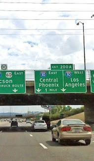 New bigger,easier to read highway signs above overpass