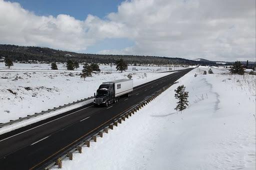 Snowy Day: Semi Truck on Interstate 40 in Arizona