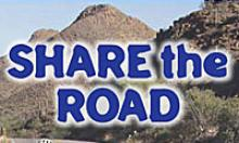 """""""Share the Road"""" on mountain background"""