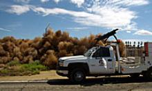 Thousands of tumbleweeds by the road with an ADOT Vehicle