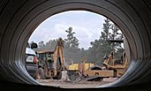 Road construction equipment as see through a window