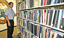 Librarian Dale Steele oversees the collection at the ADOT Research  Center Library.
