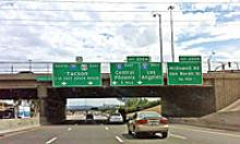 Bigger easier to read highway signs attached to Thomas Road overpass over I-17