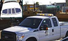 ADOT emergency vehicle with solar powered light bar and solar panel (inset)