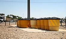 Large barrel shaped containers filled with sand designed to cushion crashes
