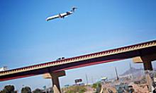 Airplane flies over SR 143