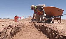 A member of the ADOT Historic Preservation Team works an archaeological site near SR 77.