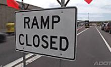 Ramp closed sign with freeway in the background
