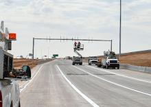 Crews work on some finishing touches to the I-10 ramps to Goodyear