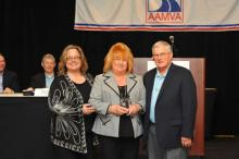 MVD Director Stacey Stanton, left, with Anne Yanofsky and outgoing AAMVA Chair, Mike Robertson.