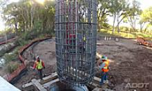 Crew works around frame of support for the new San Pedro River Bridge.