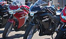 Front-end of three motorcycles lined up side by side.
