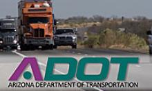 The ADOT logo with semi trucks on a road.