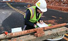 Crews gather data from core samples at the US 89 site.