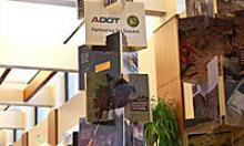 Display of photos stacked vertically, and offset ninety degrees, showcasing ADOT's recent efforts.