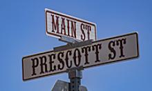 Main Street and Prescott Street signs