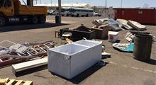 Debris removed from freeway: refrigerator, ladders, mattressses and furniture.