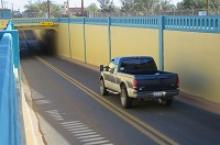 Pickup truck drive down towards Winslow underpass.