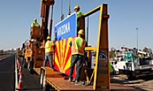 ADOT Workers working on putting up a sign