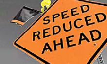 Speed reduced ahead road sign