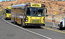 School buses lead the way down the reopened US 89