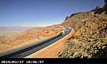Schools bus leads cars over the newly reopened section of US 89
