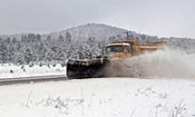 Snowplow clearing the road