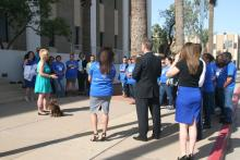 Crowd outside Motor Vehicle office for Donate Life speech.