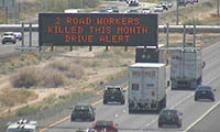 "Highway Sign: ""2 road workers killed this month - drive alert"""