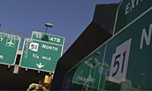 Graffiti shield on freeway sign