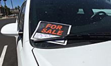 White car with a For Sale sign