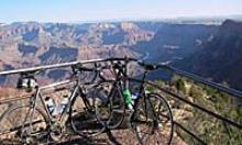 Bicycles up against railing of Grand Canyon over look.