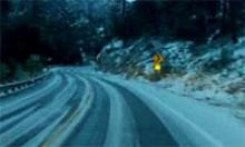 Night trip up Catalina Highway with snow falling.