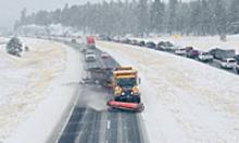Tow plow removes snow