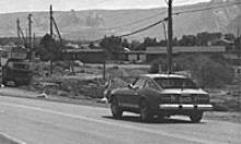 Old black and white photo of SR 179 with the red buttes in the distance