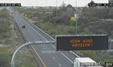 Dynamic Message Sign in the foreground of an image from a traffic camera