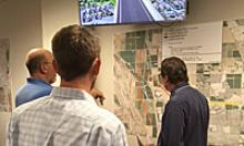 Citizens check out the Loop 303 study area map