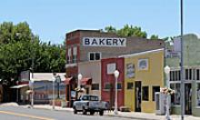 Small town main street with bakery sign