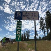 "Adopt a highway sign, ""Clint Fluhr, Forever in our hearst"""
