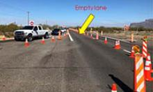 US 60 lined with traffic cones up to entrance to Renaissance Festival.